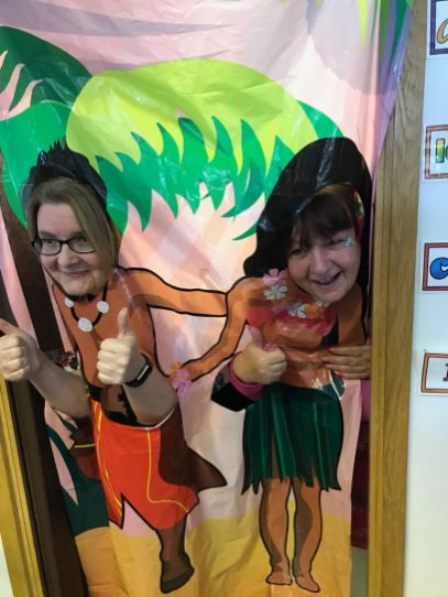 Mrs Ng kindly gave us this shot from her class photobooth. Who are they?