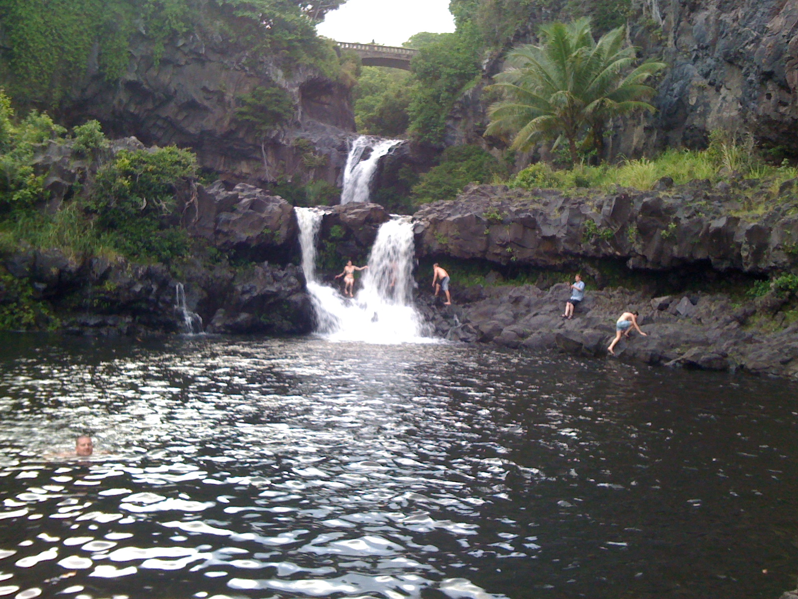 No. 1 child sits in the Oheo Pools waterfall at Haleakala National Park