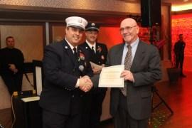 Capt. Baycan Fideli and firefighter Tom Fleischman (134 calls).