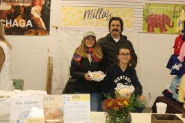 Ludmilla Benevides, proprietor of Milla's Cheese Puffs, with her husband Marcello Velloso and daughter Anabell Velloso.