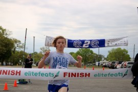 Michael Burns,  15, of Riverhead was first across the finish line.