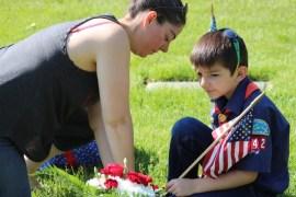 Joshua Marshall, 7,  places a flag with his mom Karma Marshall