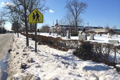 Sidewalk on Pulaski Street just east of the school is completely obstructed by snow. (RiverheadLOCAL photo by Emil Breitenbach Jr.)