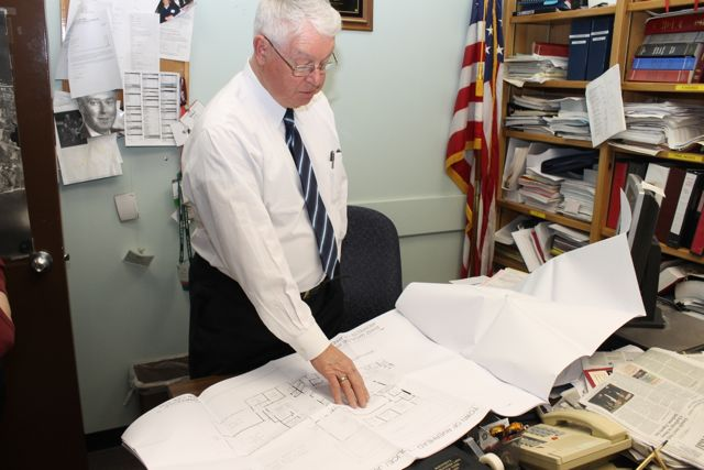 Riverhead Town Justice Allen Smith goes over plans for a new town court-police complex in the former NYS armory. (RiverheadLOCAL photo by Denise Civiletti)