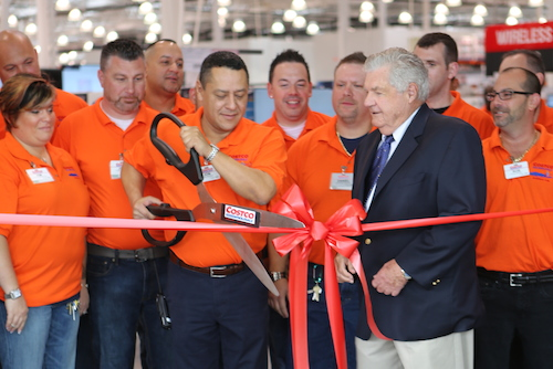 Riverhead Councilman John Dunleavy, second from right, was the only town official on hand for Costco's ceremonial ribbon-cutting for the warehouse grand opening this morning.