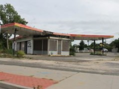 Abandoned gas station on the traffic circle in Riverside, opposite and abandoned diner.