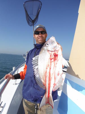 That's me in my element, after catching a 3-pound-plus porgy. Photo: Ken Holmes