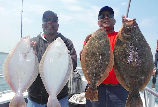 Jerry and Skip from Riverhead with some big fluke caught on the Brooklyn Girl. Courtesy photo: Ken Holmes