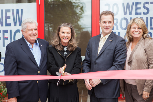 Georgia Malone and Riverhead Town Council members hold a ribbon cutting outside the new offices. Photo: Katharine Schroeder