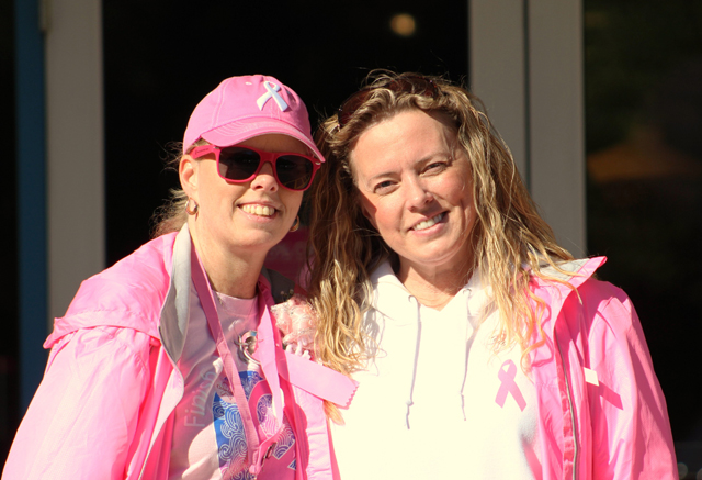 From left, Tracey of St. James, a breast cancer survivor, with her sister, Deanna, of Manorville.