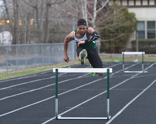 McGann-Mercy senior Luis Cintron won four events in a dual meet against Ross Monday, including the 400-hurdles. (Credit: Robert O'Rourk)