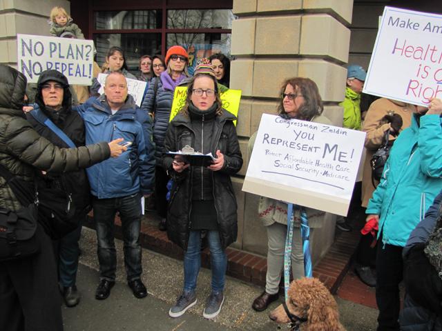 Demonstrators outside Congressman Lee Zeldin's office