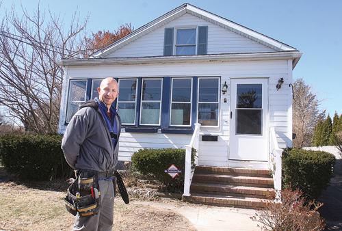 BARBARAELLEN KOCH PHOTO | Contractor Matthew Forrest bought this home in Polsih Town last December.