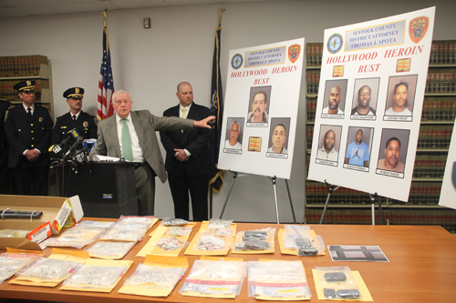 PAUL SQUIRE PHOTO | District attorney Thomas Spota points to the suspects arrested in a heroin trafficking ring at a press conference Wednesday.