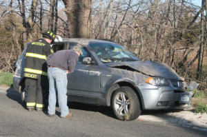 PAUL SQUIRE PHOTO   The woman driving in this BMW was not seriously injured when it flipped over, authorities said.