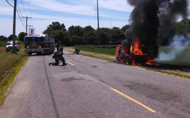 Jamesport Fire Department volunteers extinguish a vehicle fire on Tuthills Lane in jamesport Sunday. (Credit: Jamesport Fire Department)