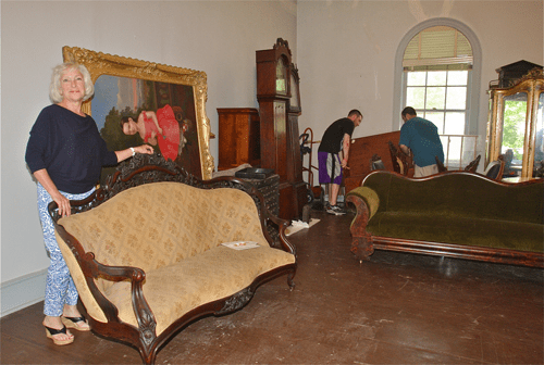 Suffolk County Historical Society executive director Kathy Curran in the organization's East Wing Gallery Thursday.  Workers are moving furniture and artwork into storage while the space is restored. (Credit: Barbaraellen Koch)