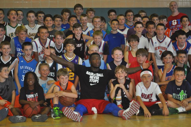 NBA guard Nate Robinson poses for a picture during Tuesday's camp at McGann-Mercy High School. (Credit: Joe Werkmeister)