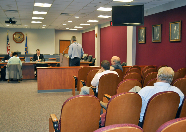 A handful of residents spoke at a forum Tuesday about the upcoming shortage of area codes. (Credit: Claire Leaden)