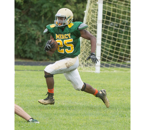 Reggie Archer, a fourth-year varsity player for McGann-Mercy who lives in Riverhead, will be the featured back for the Monarchs this season. (Credit: Robert O'Rourk)