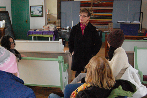 The Rev. Dianne Rodriguez (center) speaks with members of First Parish Church in Northville last week. (Credit: Cyndi Murray)