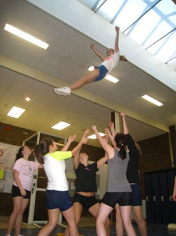 Shoreham cheerleaders practicing stunts in a hallway area in the high school in 2011, which girls at the time contended was not an appropriate space for practice. (Courtesy photo)