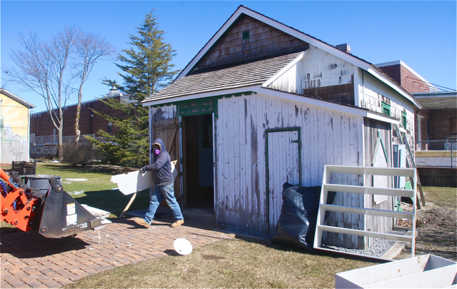 'Building and Grounds workers were at the Fresh Pond School house Thursday morning doing renovations to the Fresh Pond Schoolhouse. (Credit: Barbarellen Koch)