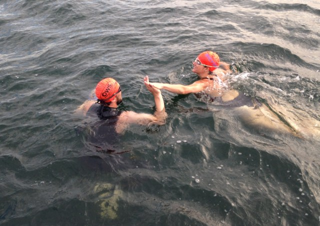 Swimmers switched in the relay by giving one another a mandatory high-five. (Credit: Courtesy)