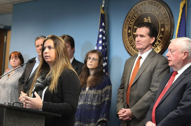 Melanie Stafford speaks at a press conference in Hauppauge Tuesday with Suffolk County District Attorney Thomas Spota (far right), state Senator John Flanagan (second from right) and family members of hit-and-run victims. Ms. Stafford's uncle was killed in 2012 while crossing the street in downtown Riverhead. (Credit: Jen Nuzzo)