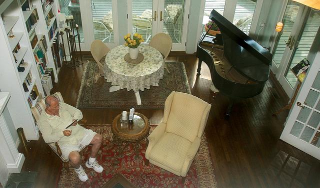 The view from Ms. Deegan's second-floor office as Mr. Deegen relaxes in the living room. (Credit: Barbaraellen Koch)
