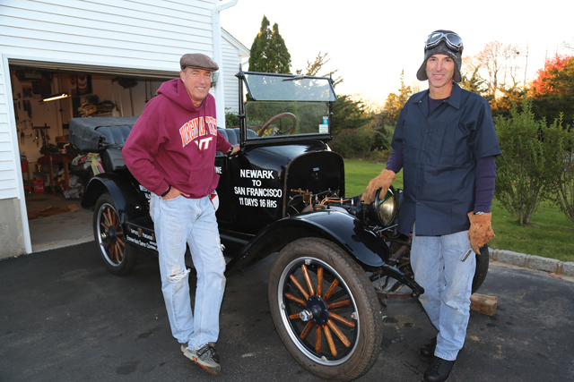 Rich Bassemir (left) and his brother Doug with their 1917 Maxwell touring car in Aquebogue last Friday. (Credit: Krysten Massa)