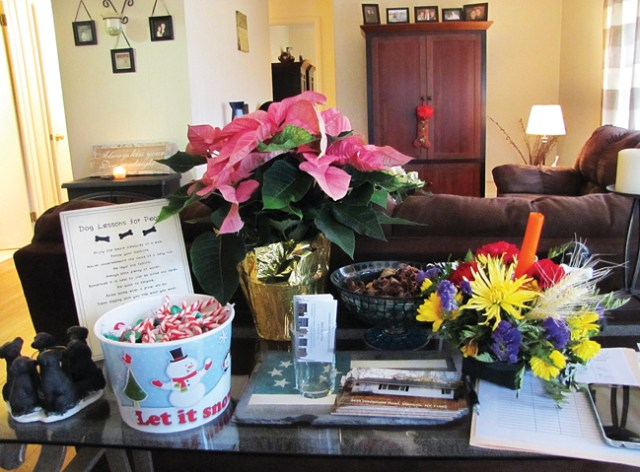 Candy canes, flowers and other decorations — including a holiday-themed doormat and Christmas table runner — helped make this open house in Mattituck more appealing, said real estate agent Beth Pike. (Credit: Paul Squire)