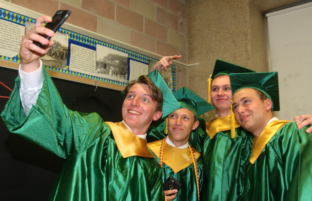 Aldo Geraci of Riverhead (from left), Alex Frabizio of Patchogue, Josh Elio of Shirley and Nick Gardner of Riverhead pose for a selfie after donning their graduation gowns and caps. (Credit: Barbaraellen Koch)