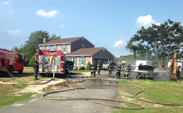 Jamesport firefighters put out a vehicle fire Tuesday afternoon. (Credit: Nicole Smith)