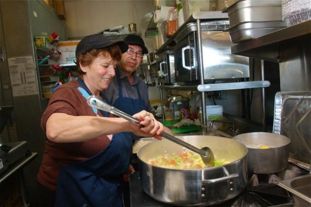 Ioanna and Manolis Kavvadias cooking up vegetables for soup Friday morning at Greek Bites Grill in Mattituck. (Credit: Barbaraellen Koch)
