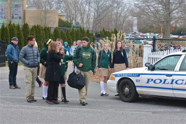 Students leave Mercy High School Wednesday. (Credit: Barbaraellen Koch)