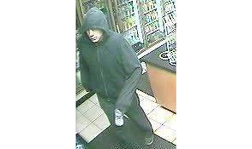 SURVEILLANCE PHOTO | Suffolk police said Paul Tromblee of Manorville has been identified as the man in this surveillance photo. He is charged with nine counts of armed robbery.