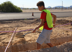 Jace Taylor digs a trench on the Island Thursday morning. Jillian Danielson/RiverScene