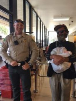 Deputy Johnson and the unidentified man he helped were all smile after the touching encounter. Pamela Johnson photo