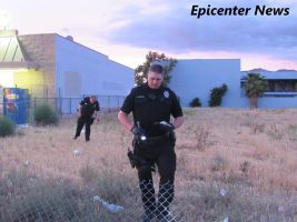After finding the gun, a Hemet Police officer collected the weapon as evidence. Epicenter News photo
