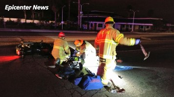 Firefighters work to stabalize and treat the unidentified motorcyclist. William Hayes / Epicenter News photo