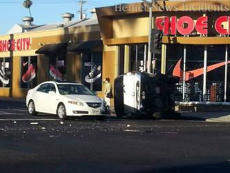 The brown SUV rolled onto its' side temprorarily trapping the driver. Oscar Ramirez photo