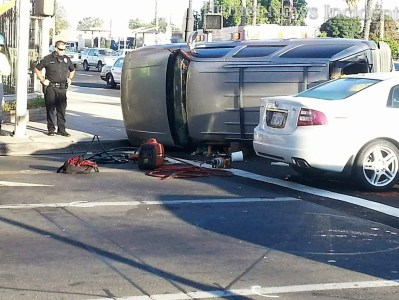A female driver waits inside her rolled over SUV to be extricated from her vehicle. Oscar Ramirez photo