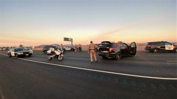 Numerous officers and deputies responded to the emergency on the I-215 freeway. William Hayes photo