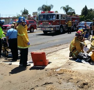 Firefighters and paramedics tend to the injured from the hit and run traffic collision. Ricardo Ruelas photo