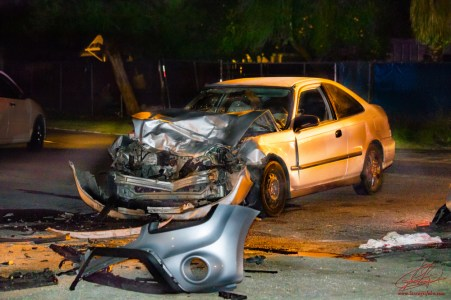 Debris and vehicle parts were strewn across the entire roadway after the violent head-on collision. John Strangis photo