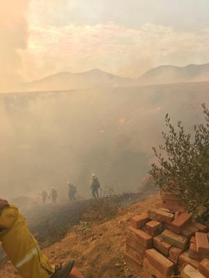 A line of fire fighters moves deeper into a canyon towards the growing fire. Robert Carter photo