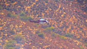 A Cal Fire helicopter returns to base to refill after a successful water drop on the fire. Miguel Shannon photo