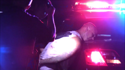 Hemet officers search Grigsby after his arrest. Miguel Shannon photo