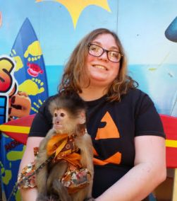 Sara got to meet and hold a monkey during her visit to the pumpkin patch.
